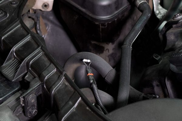Our chosen resistor inserted into the PCV heater's harness for testing.