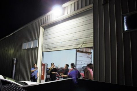 Here we see guys who just want to have fun. That's AJ in the plaid shirt and Justin to his left, in Justin's shop