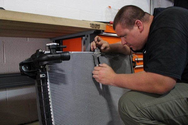 Dan measuring the fins of the stock Nissan Titan XD radiator