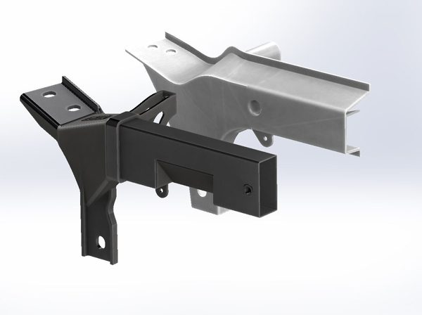 The closed structure of the Mishimoto bar vs. the open design of the stock helps add rigidity and solidity.