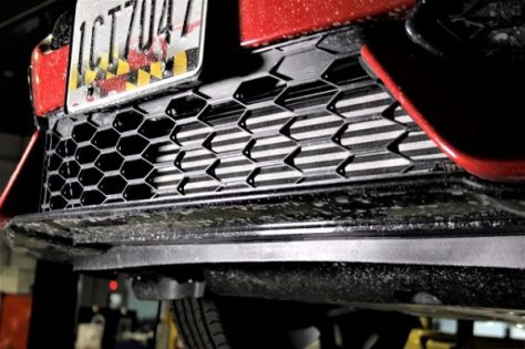 Front grill revealing the stock intercooler