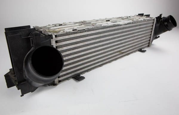The Stock intercooler unit. Note the guides on the end tanks for seamless mounting under the primary radiator.