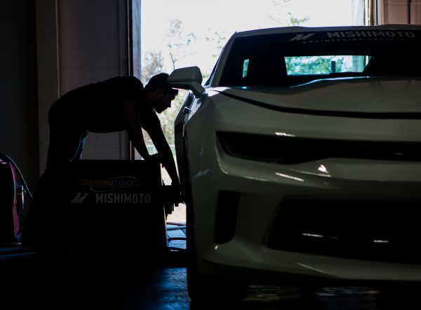 Steve slides one of the Dynapack pods into place to start dyno testing on the Camaro.