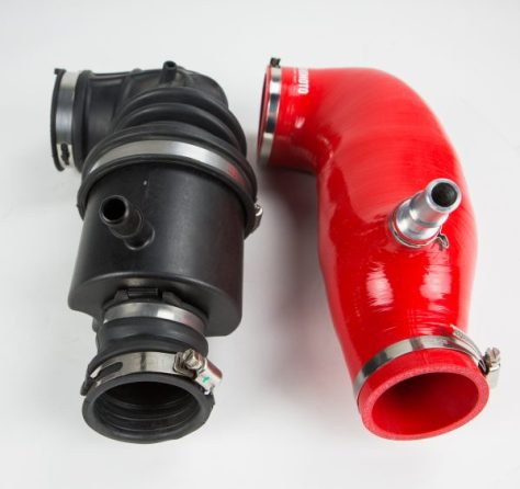 A side by side comparison of the stock and silicone hoses. We've removed the intake muffler for a better engine tone, and included a CNC machined PCV quick disconnect valve.