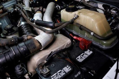 Stock intercooler in the engine bay of the truck, it's much dirtier!