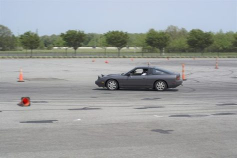 This S13 had a swapped Honda engine screaming through the track