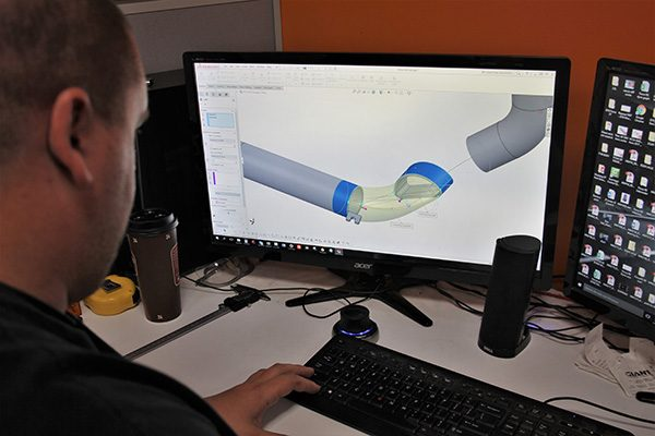 Dan redesigning the intercooler pipe via CAD software