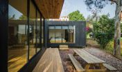 Revolution Architects designed the Black Cabin_ a compact green_roofed dwelling surrounded by nature.