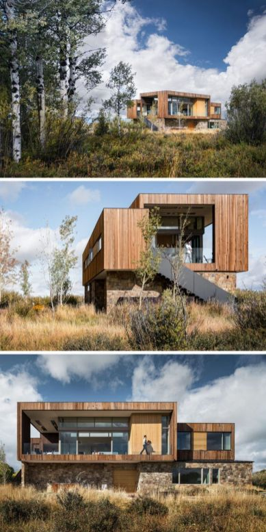This modern house has a material palette of earthen rock and stained wood_ that attempts to tie the . _ModernHouse