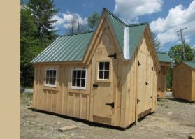 12x14 Dollhouse _ Constructed with an evergreen roof_ board and batten siding and barn sash windows.
