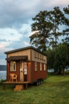 A 160 sq.ft. tiny house built on a triple_axle trailer. The house includes two lofts and a downstairs area that can be used as a bedroom or home office. (1)