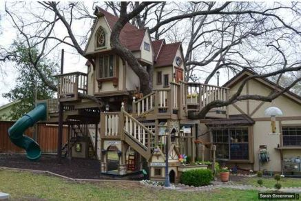 A grandfather built this tree house for his grandsons. It has a slide_ rock climbing wall_ and zip line. Perfectio