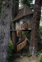 Artist Jay Nelson stands with Daria Joseph in front of the treehouse he built for her on commission . Photo_ Micha