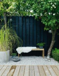 Garden design_ a contemporary Scandi inspired makeover. Alice in Scandiland. love the black against wood against gravel with grasses _gardendesign