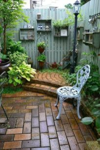 Garden wall with shelves makes a private place to sit quietly. _ Garden
