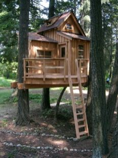 Lainey loves this treehouse.... if we only had big trees_