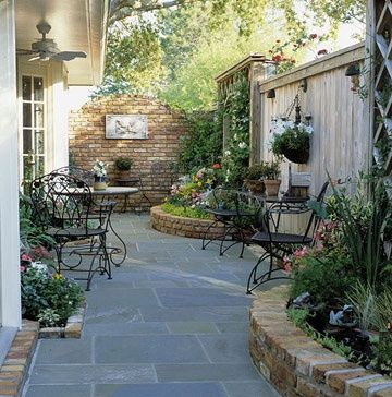 Nice patio & raised gardens _ even a small irrigular shaped lot has potential and lots of appeal