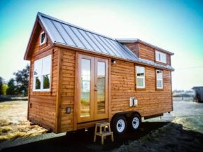 """Some of the tiny houses that we see are the pure embodiment of """"cozy"""" and this is one of them_ Built. The builders say that this was the most advanced tiny house they had ever built bef"""