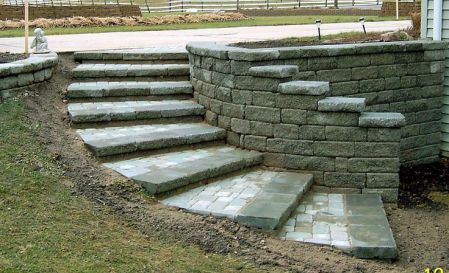 curved retaining wall ideas _ The tread was built using Moss Creta Wall Capstone and a custom ...