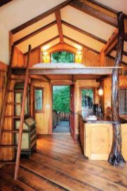 economical cabin. no walls for bedroom_ no stairs_ but big enough for living area and kitchen.