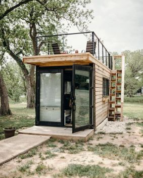 """upknorth_ """" Less indoor_ more outdoor. _getoutdoors _upknorth 20' container turned tiny house with rooftop deck. Built by _cargo_home. Photo by _alexis_mccurdy (at Waco_ Texas) """""""