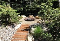 backyard-copper-fire-pit-with-gravel-sitting-area-and-wood-steps