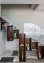 Wooden-boxes-turn-the-space-under-the-stairway-into-a-cool-display