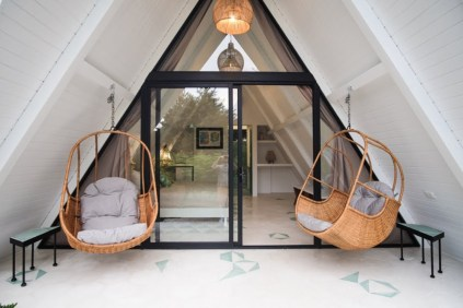 A-frame-Tiny-Homes-Fit-for-a-Vacation-hanging-chairs