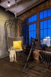 An-open-space-with-glass-partitions-hanging-chair