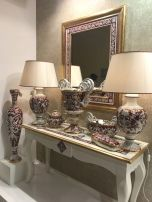 Baroque-framed-mirror-and-porcelain-accessories-lamp-and-vases