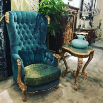 Baroque-or-rococo-reading-corner-with-blue-velvet-high-back-armchair