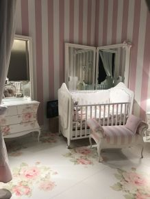Nursery-room-with-pale-pink-accents-and-floral-patterns-on-floor-and-furniture