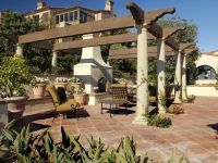 SPanish-house-with-large-pergola-and-outdoor-fireplace