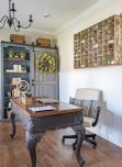 a-French-farmhouse-home-office-with-a-built-in-blue-storage-unit-a-vintage-desk-a-leather-chair-and-a-storage-unit-on-the-wall