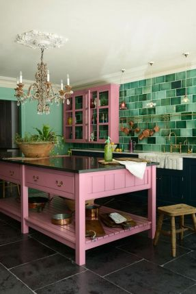 a-bold-kitchen-with-black-lower-cabinets-upper-pink-ones-a-pink-kitchen-island-a-bold-green-tile-backsplash-and-a-chic-chandelier