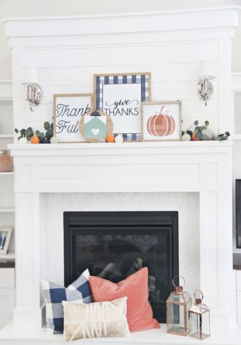 a-bright-Thanksgiving-mantel-with-bold-signs-greenery-and-mini-pumpkins-and-matching-pillows-at-the-fireplace