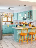 a-bright-blue-kitchen-with-a-tiled-backsplash-orange-chair-floral-shades-and-retro-lamps-is-a-very-cool-idea