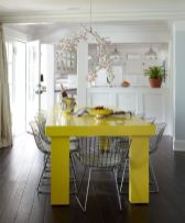 a-bright-contemporary-dining-space-with-a-neon-yellow-table-and-grey-metal-chairs-plus-a-whimsical-cherry-blossom-chandelier