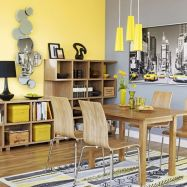 a-bright-grey-and-yellow-dining-room-with-a-grey-and-a-yellow-accent-wall-an-open-storage-unit-a-stylish-dining-set-and-lemon-yellow-pendant-lamps