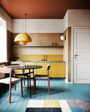 a-bright-modern-kitchen-with-yellow-cabinets-and-a-pendant-lamp-a-blue-floor-and-blue-countertops-plus-a-geometric-rug