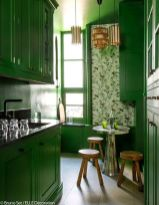 a-bright-yellow-kitchen-with-floral-wallpaper-a-metal-table-wooden-stools-and-pendant-lamps-is-a-very-sophisticated-space