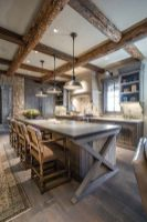 a-chalet-kitchen-with-rough-wooden-cabinetry-and-kitchen-island-stone-countertops-wooden-beams-and-pendant-lamps-and-vintage-stools