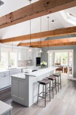 a-chic-dove-grey-contemporary-kitchen-with-a-two-level-kitchen-island-rich-tone-woodne-beams-pendant-lamp-and-dark-wooden-stools