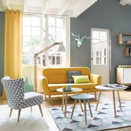 a-chic-living-room-with-grey-walls-a-yellow-sofa-and-a-printed-chair-yellow-curtains-and-round-coffee-tables