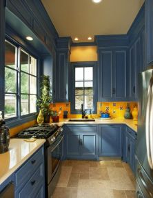 a-colorful-kitchen-with-navy-cabinets-and-a-bold-yellow-backsplash-with-a-bright-yellow-countertops-feels-country-like-and-fun