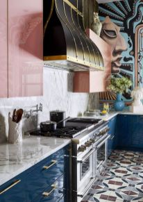 a-colorful-kitchen-with-navy-lower-cabinets-pink-upper-ones-a-marble-backsplash-and-a-vintage-hood-to-make-a-statement