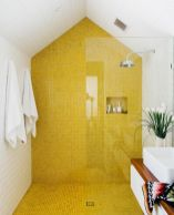 a-contemporary-bathroom-with-a-bold-yellow-tile-wall-and-floor-in-the-shower-to-make-this-space-bolder-and-catchier