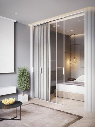 a-contemporary-neutral-bedroom-with-an-upholstered-bed-some-lights-and-pendant-lamps-and-curtains-over-a-glass-wall-that-connects-it-to-the-rest-of-the-house