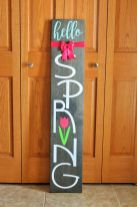 a-dark-stained-wooden-sign-with-a-pink-bow-and-a-pink-tulip-is-a-lovely-idea-for-outdoors