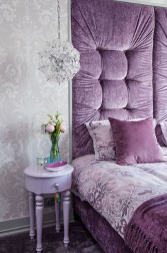 a-glam-bedroom-with-gray-wallpaper-a-purple-bed-built-in-a-niche-a-lavender-nightstand-and-a-crystal-sphere-pendant-lamp